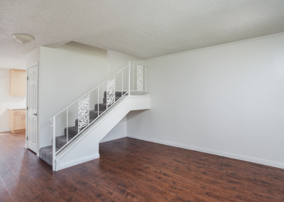Empty living room with stairs