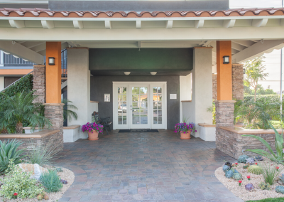 Villa Del Sol leasing office with landscaping and pathway